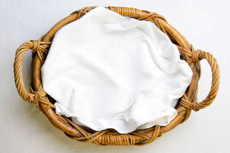 wicker basket: Top view, bakery basket with napkin on the white tablecloth Stock Photo