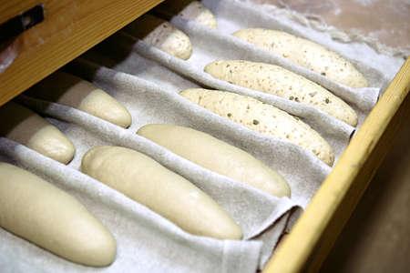 A few crude baguette on the bakery shelf