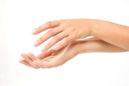 Beautiful womans hands on the white backround Stock Photo