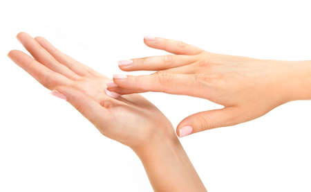 Beautiful womans hands with pink care cream on the palm Stock Photo