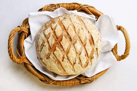 Rustic bread in the bakery basket with napkin photo
