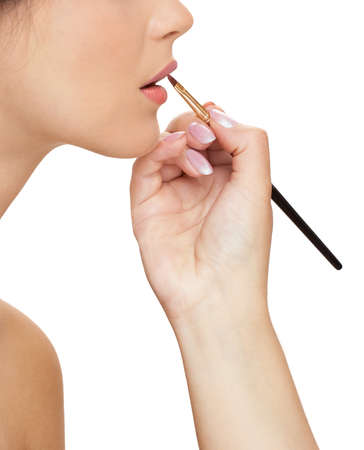 Make-up artist are working with young womans lips Stock Photo
