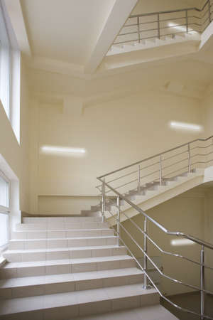 fluorescent light: Stairway with metal handrails in the new modern building