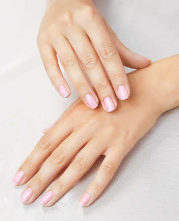 Massage of womans hand on the white tablecloth Stock Photo