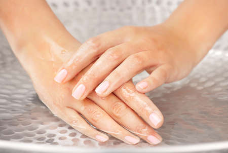 Womans hands humidification in the sink with water Stock Photo