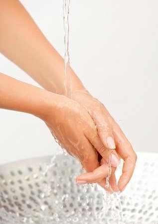 Water stream and splashing on woman