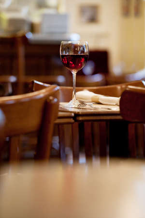 Glass of wine on the table in little French restaraunt photo