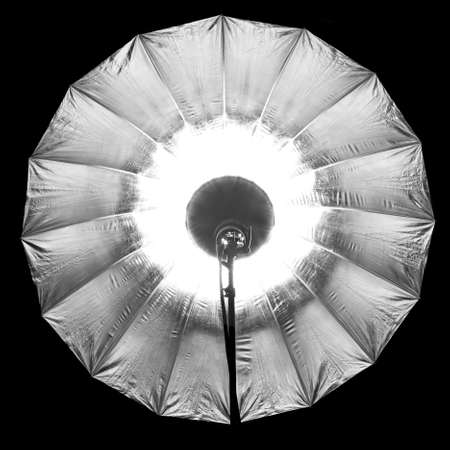 Photographic silver large umbrella brightened right in the frame