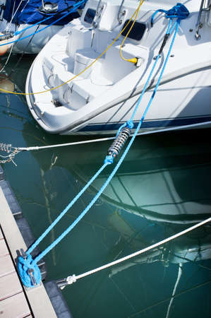 moorings: Yacht in safe port at moorings Stock Photo