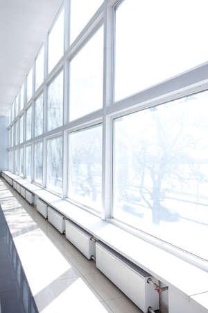 Empty Room with Big White Windows and radiators  Stock Photo