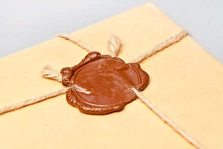 Envelope with wax seal tied with twine