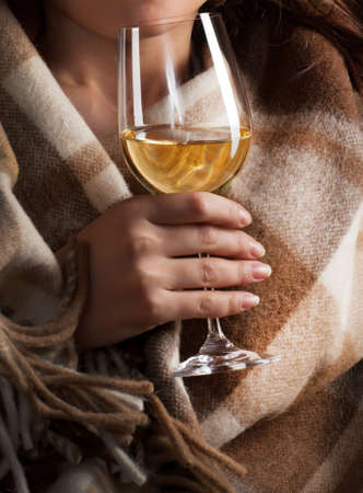 Glass of wine in womans hands
