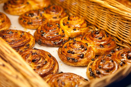 Buns with raisins in the basket Stock Photo