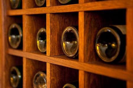Wine Bottles rack. Wooden wine rack in the french restaurant