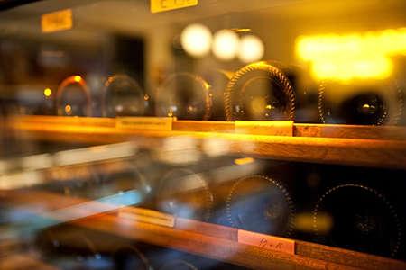 Wine Bottles rack. Glassy wine rack in the french restaurant