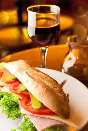 サンドイッチとワインと瓶のガラス 写真素材