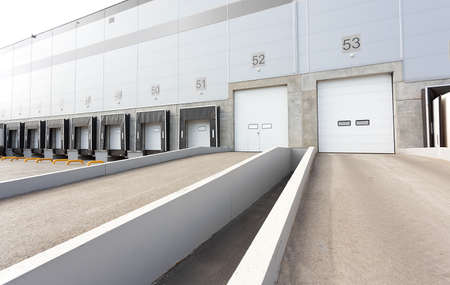 Big distribution warehouse with gates for loading goods 스톡 콘텐츠