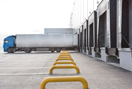 loading bay: Loading big blue truck at the big distribution warehouse with gates