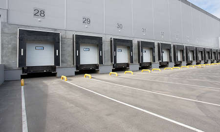 loads: Big distribution warehouse with numbering gates for loads