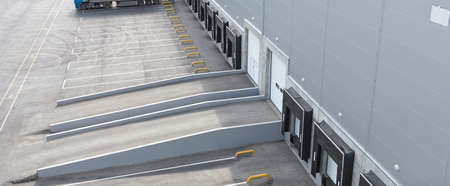 loading bay: Big distribution warehouse with gates for loading goods Stock Photo