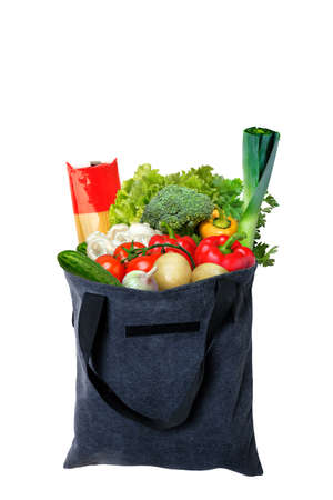Eco-friendly gray reusable shopping bag filled with different fruits, vegetables and pasta.