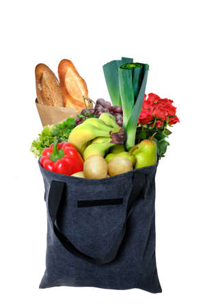 Eco-friendly gray reusable shopping bag filled with different fruits, vegetables and bread. 版權商用圖片