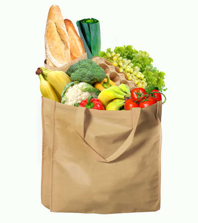 Eco-friendly reusable shopping bag filled with different fruits, vegetables and bread.