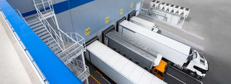 Top view of Big distribution warehouse with gates for loads and trucks 版權商用圖片