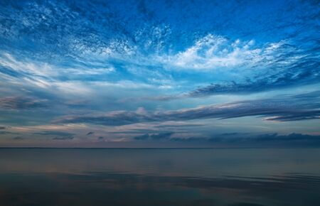 Blue sea, sky and clouds