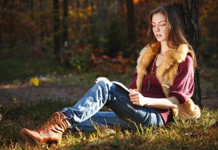 Autumn girl reading a book