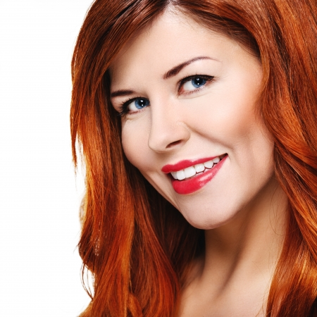 Beautiful smiling woman with red hair Stock Photo