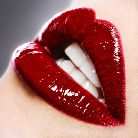 Beautiful female with red shiny lips close up Stock Photo