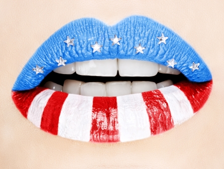 Beautiful female lips painted with American flag