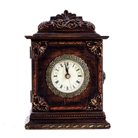 Antique clock about to hit midnight or noon