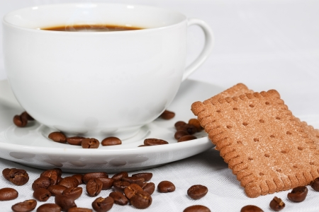 Cup of coffee, beans and biscuits Stock Photo