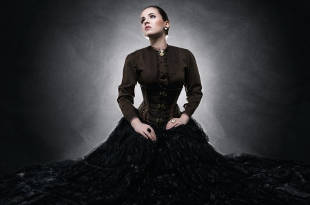 Beautiful fashionable woman in gothic style 免版税图像