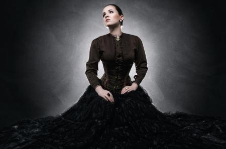 Beautiful fashionable woman in gothic style Standard-Bild