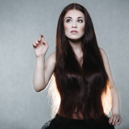 Beautiful woman with very long hair photo