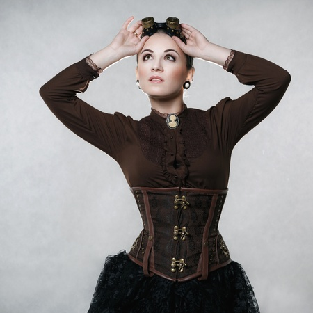 Beautiful fashionable woman in the style of steampunk