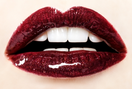 Beautiful red glossy lips close up photo