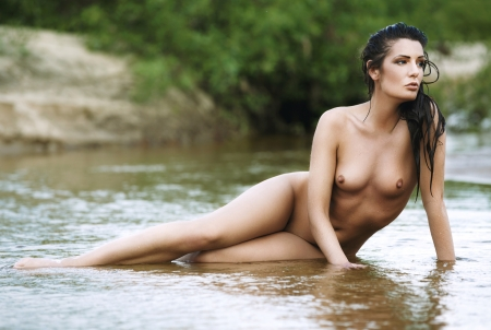nude outdoors: Beautiful naked woman in water  Stock Photo