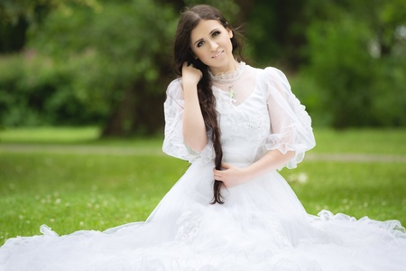 Beautiful woman in a gothic wedding dress photo
