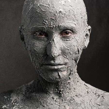 Statuesque woman with fissured skin Standard-Bild