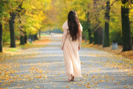 Mysterious lonely woman departing off into the distance  Stock Photo - 23129829