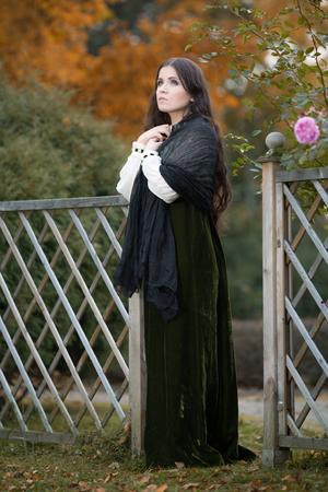 Beautiful woman in autumn park  photo
