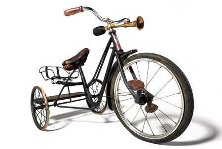 antique tricycle: Old bike in retro style on a white