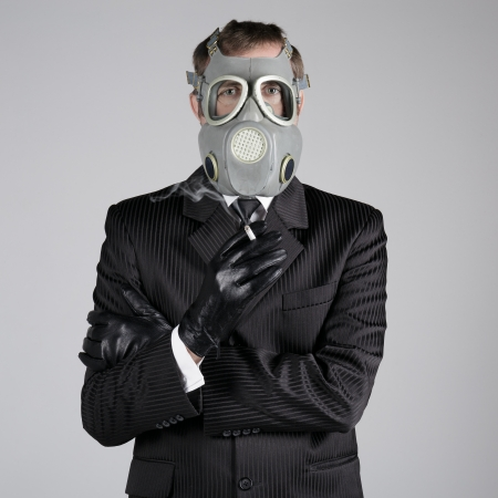Man in a gas mask with a cigarette  photo
