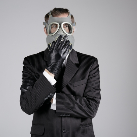 dangerous ideas: Man in a gas mask with a cigarette  Stock Photo