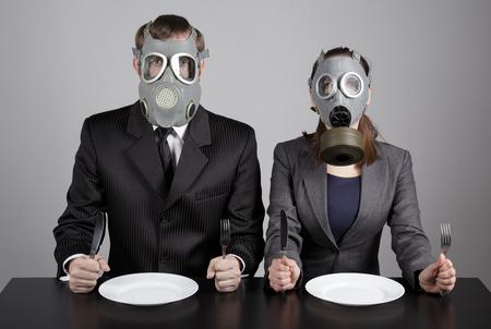 Couple at gas masks  photo