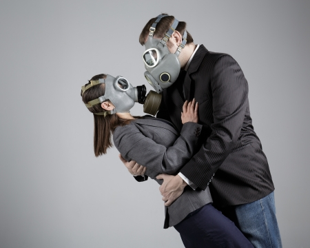 Couple in love in gas masks